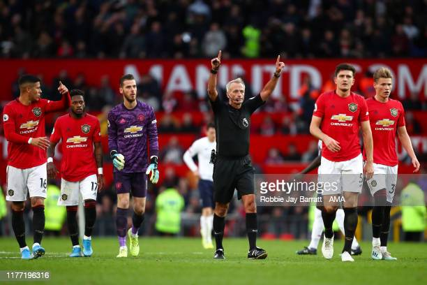 match referee Martin Atkinson confirms Sadio Mane of Liverpool is disallowed after a VAR review during the Premier League match between Manchester...