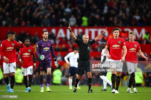 Match referee Martin Atkinson confirms that Sadio Mane of Liverpool's goal was ruled out for Handball by VAR during the Premier League match between...