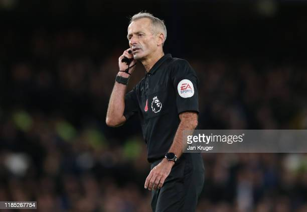 Match Referee Martin Atkinson during the Premier League match between Everton FC and Tottenham Hotspur at Goodison Park on November 03, 2019 in...