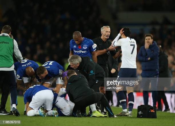 Match Referee Martin Atkinson embraces Son HeungMin of Tottenham Hotspur during the Premier League match between Everton FC and Tottenham Hotspur at...