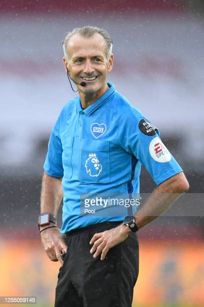 Match referee Martin Atkinson in action during the Premier League match between Sheffield United and Wolverhampton Wanderers at Bramall Lane on July...