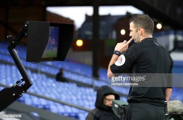 Match Referee Michael Oliver checks the VAR pitch side review screen during the FA Cup Third Round match between Crystal Palace and Derby County at...