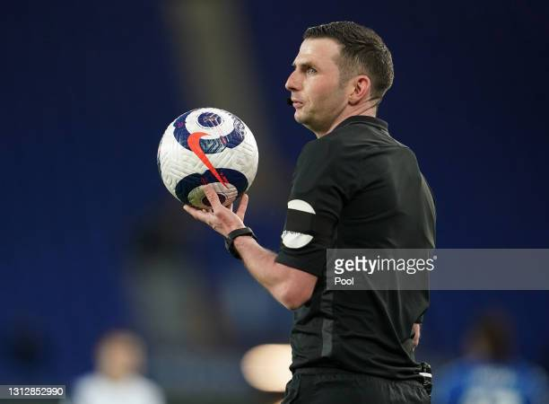 Match referee Michael Oliver holds the blue and white Premier League Nike Flight match ball during the Premier League match between Everton and...