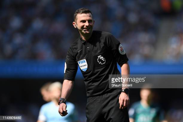 Match Referee Michael Oliver looks on during the Premier League match between Manchester City and Tottenham Hotspur at Etihad Stadium on April 20...