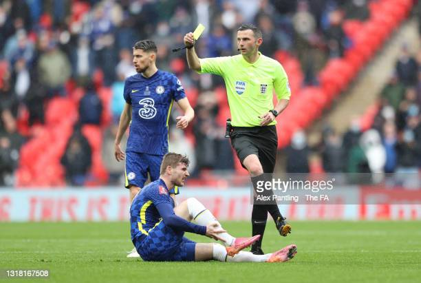 Match Referee, Michael Oliver shows a yellow card to Wesley Fofana of Leicester City after a foul on Timo Werner of Chelsea during The Emirates FA...