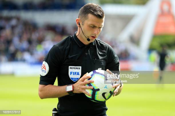 Match Referee Michael Oliver tests the match ball prior to the Premier League match between Huddersfield Town and Cardiff City at John Smith's...