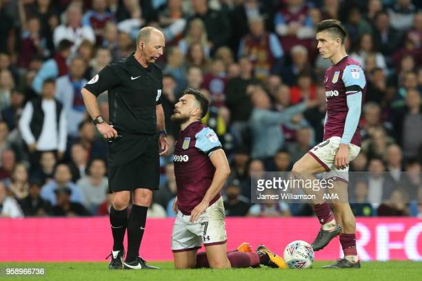 Match referee Mike Dean and Robert Snodgrass of Aston Villa and Jack Grealish of Aston Villa during the Sky Bet Championship Play Off Semi...
