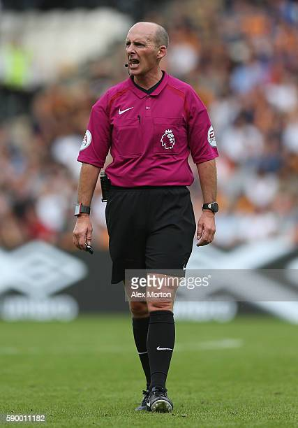 Match referee Mike Dean during the Premier League match between Hull City and Leicester City at KC Stadium on August 13 2016 in Hull England