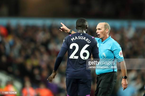 Match referee Mike Dean orders Arthur Masuaku of West Ham United to leave the field after picking up a second Yellow card during the Premier League...