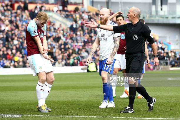 Match Referee Mike Dean points to the penalty spot as Ben Mee of Burnley points to his arm during the Premier League match between Burnley FC and...