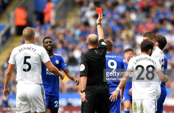 Match Referee Mike Dean shows Jamie Vardy of Leicester City a red card during the Premier League match between Leicester City and Wolverhampton...