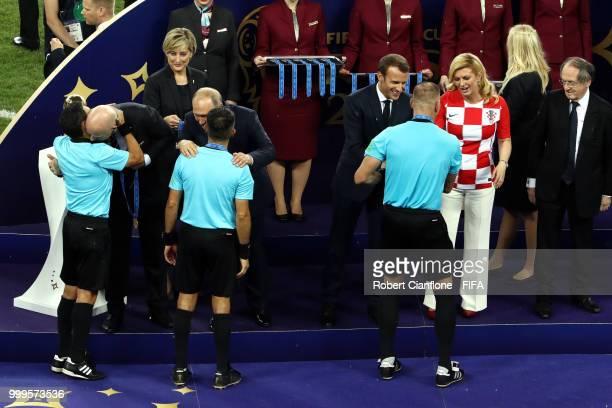 Match Referee Nestor Pitana and Assistant Referees Hernan Maidana and Juan Pablo Belatti receive their medalsls following the 2018 FIFA World Cup...