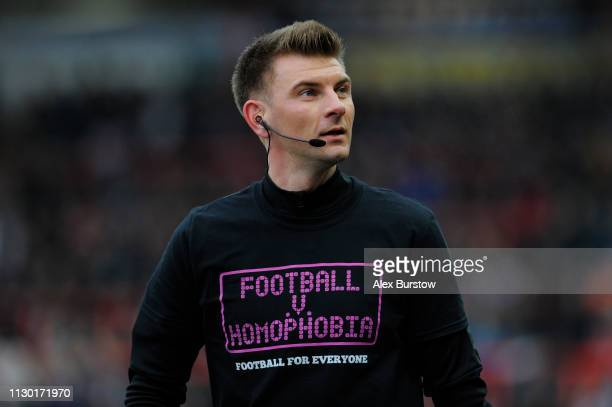 Match Referee Ollie Yates looks on as he warms up wearing a Football v Homophobia campaign tshirt as part of Exeter City's designated annual Football...
