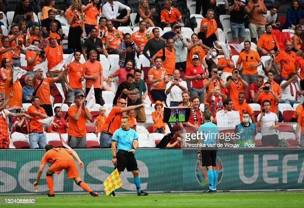 Match Referee, Orel Grinfeeld checks the VAR screen before awarding a penalty to Netherlands as fans of Netherlands react during the UEFA Euro 2020...