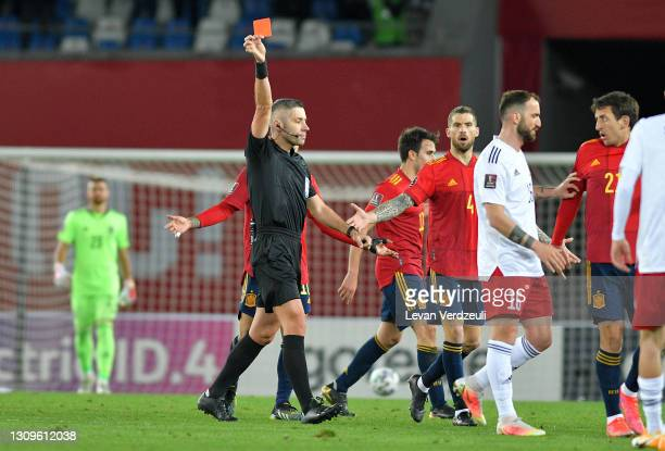 Match Referee, Radu Marian Petrescu shows a red card to Levan Shengelia of Georgia during the FIFA World Cup 2022 Qatar qualifying match between...