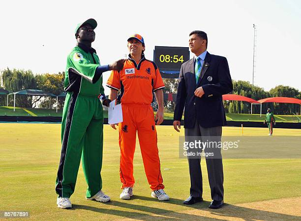 Match Referee Roshan Mahanama of Sri Lanka oversees the toss with the two captains Steve Tikolo of Kenya and Jeroen Smits of the Netherlands during...