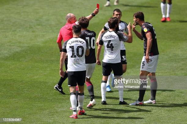 Match referee Scott Duncan shows Matt Miazga a Red Card after Tom Lawrence of Derby County clashes with Matt Miazga of Reading at full time of the...