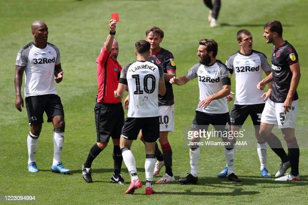 Match referee Scott Duncan shows Tom Lawrence a Red Card after Tom Lawrence of Derby County clashes with Matt Miazga of Reading at full time of the...