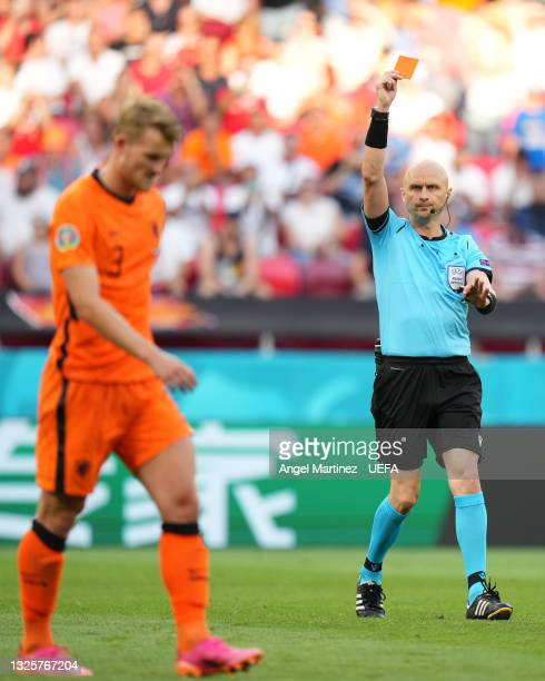 Match Referee, Sergei Karasev shows a red card to Matthijs de Ligt of Netherlands after a VAR review during the UEFA Euro 2020 Championship Round of...