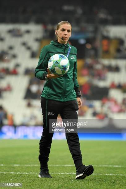 Match referee Stephanie Frappart inspects the pitch ahead of the UEFA Super Cup match between Liverpool and Chelsea at Vodafone Park on August 14...