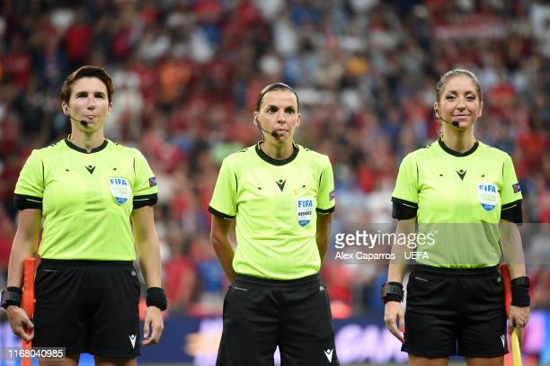 Match referee Stephanie Frappart looks on with assistant referees Manuela Nicolosi and Michelle O'Neill during the UEFA Super Cup match between...