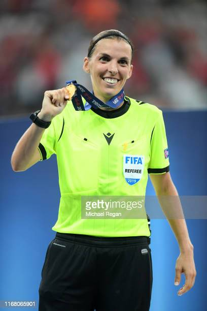 Match referee Stephanie Frappart poses with her medal following the UEFA Super Cup match between Liverpool and Chelsea at Vodafone Park on August 14...