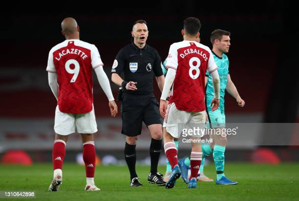 Match Referee Stuart Attwell speaks with Alexandre Lacazette and Dani Ceballos of Arsenal during the Premier League match between Arsenal and...