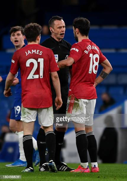 Match Referee, Stuart Attwell speaks with Daniel James and Bruno Fernandes of Manchester United during the Premier League match between Chelsea and...