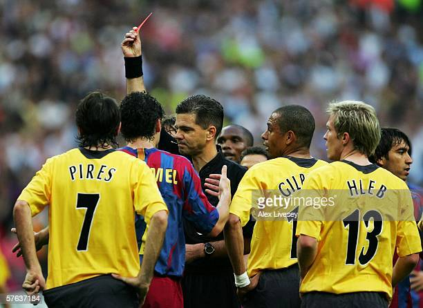 Match referee Terje Hauge shows the red card to Jens Lehmann the Arsenal goalkeeper for fouling Samuel Eto'o of Barcelona during the UEFA Champions...