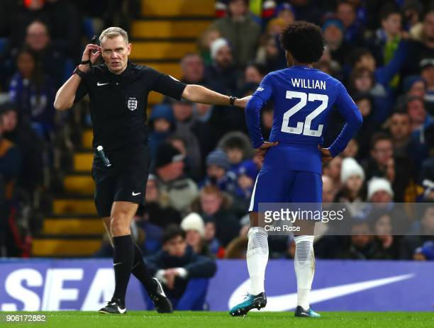 Match referee uses the VAR system during The Emirates FA Cup Third Round Replay between Chelsea and Norwich City at Stamford Bridge on January 17...