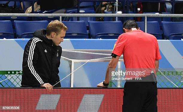 Match Referee Viktor Kassai uses the video assistant referee to make a decision during the FIFA Club World Cup Semi Final match between Atletico...
