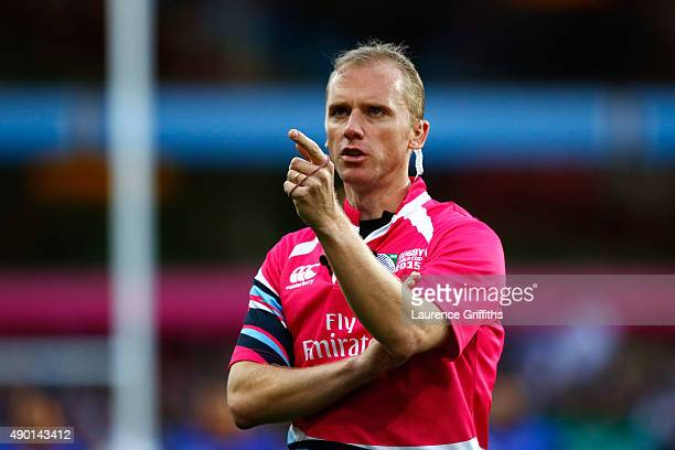 Match referee Wayne Barnes points during a television match official replay during the 2015 Rugby World Cup Pool B match between South Africa and...