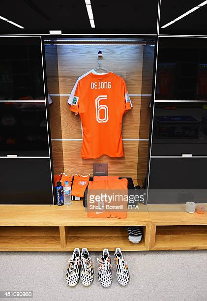 A match shirt worn by Nigel de Jong of the Netherlands hangs in the dressing room prior to the 2014 FIFA World Cup Brazil Group B match between...