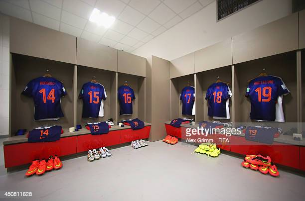 Match shirts worn by players of the Netherlands hang in the dressing room prior to the 2014 FIFA World Cup Brazil Group B match between Australia and...