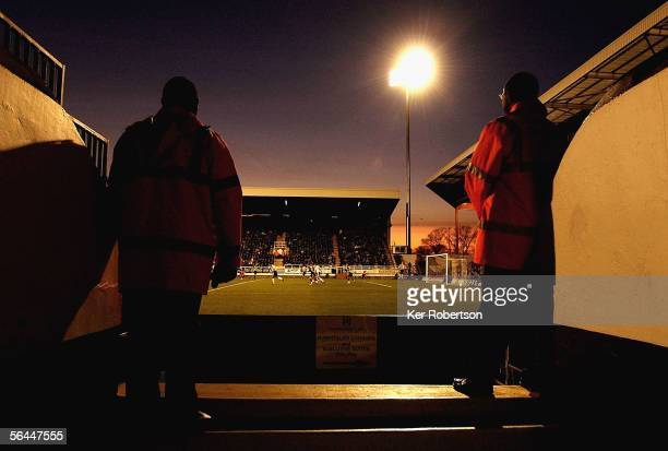 Match stewards watch from the stand during the Barclays Premiership match between Fulham and Blackburn Rovers at Craven Cottage on December 17, 2005...