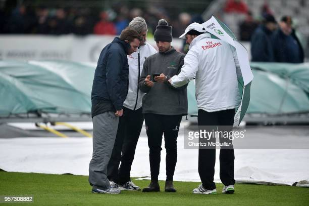 Match umpires and groundstaff check the latest weather forecast as rain delays play ahead of Ireland's first ever test cricket match against Pakistan...