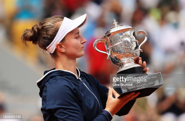 Match Winner Barbora Krejcikova of Czech Republic celebrates with the winners trophy after the Women's final on day fourteen of the 2021 French Open...