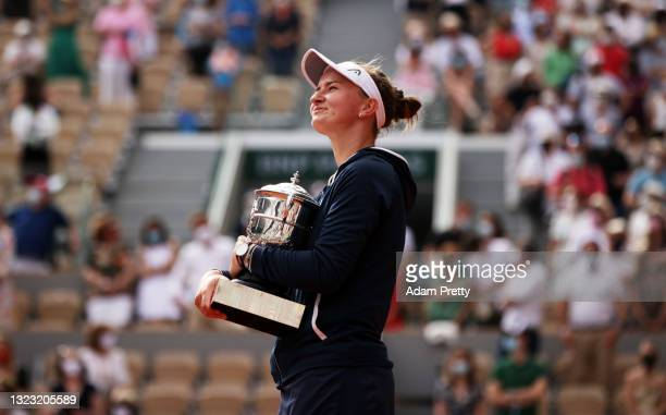 Match Winner Barbora Krejcikova of Czech Republic holds the Winners Trophy after the Women's final on day fourteen of the 2021 French Open at Roland...