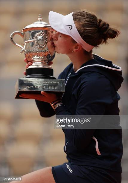 Match Winner Barbora Krejcikova of Czech Republic kisses the winners trophy after the Women's final on day fourteen of the 2021 French Open at Roland...