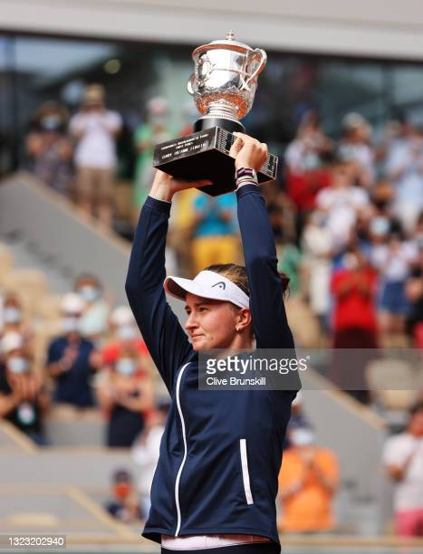 Match Winner Barbora Krejcikova of Czech Republic lifts the Winners Trophy after the Women's final on day fourteen of the 2021 French Open at Roland...
