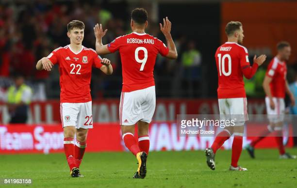 Match winner Ben Woodburn of Wales celebrates victory with team mate Hal RobsonKanu after the FIFA 2018 World Cup Qualifier between Wales and Austria...