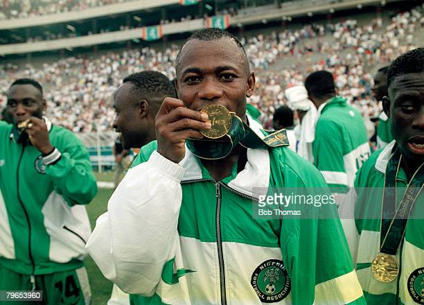 Match winner Emmanuel Amunike of the Nigeria football team kisses his gold medal after the team beat Argentina 3 - 2 in the final of the Men's...