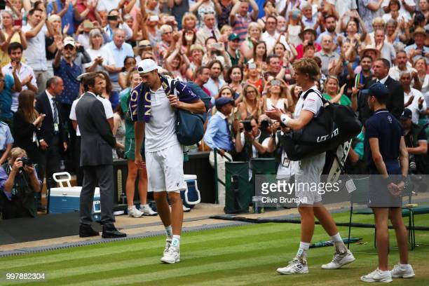 Match winner Kevin Anderson of South Africa applauds John Isner of The United States as they leave Centre Court after their Men's Singles semifinal...