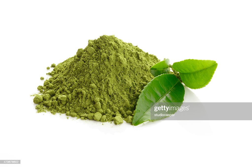 Matcha/ Green Tea powder and fresh green tea leaves