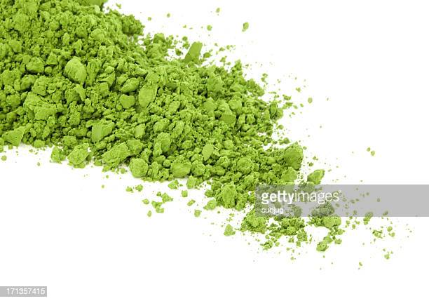 Matcha green tea spilt over the white surface