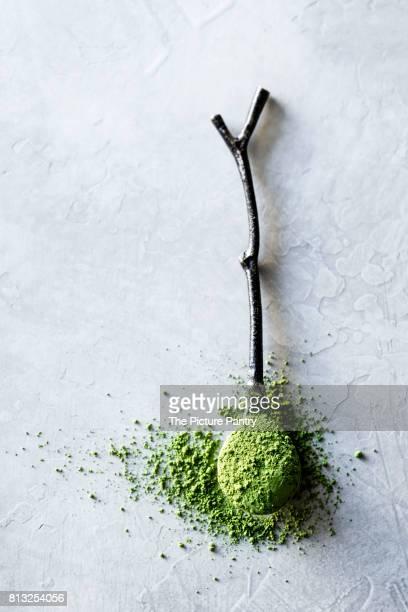 Matcha powder on a wooden twig spoon