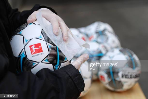 Matchballs are cleaned with disinfectant wipes prior to the Bundesliga match between 1. FSV Mainz 05 and RB Leipzig at Opel Arena on May 24, 2020 in...