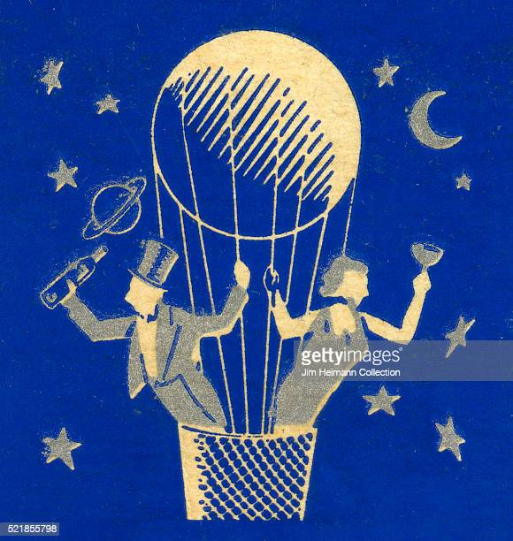 Matchbook image of a couple in evening wear in a hot air balloon holding a bottle and glass of champagne against a backdrop of stars and the moon...