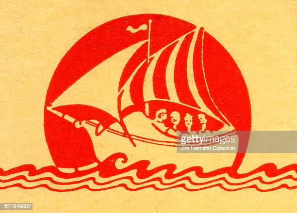 Matchbook image of ship sailing on sea silhouetted in front of a large sun