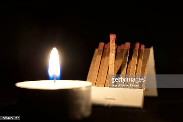 Matchbook next to a candle